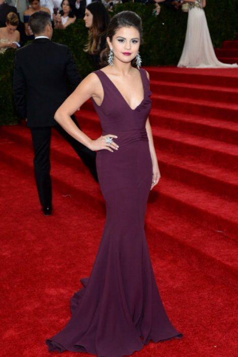 girl wearing purple and burgandy dress