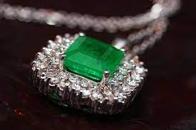 Silver ring with emerald green stone